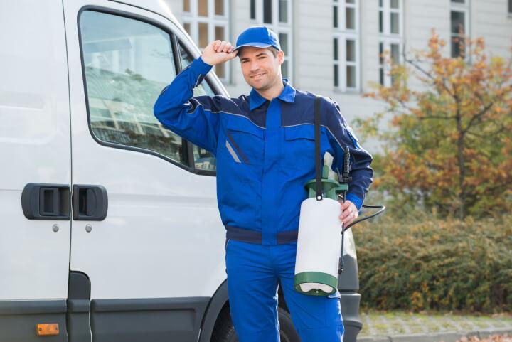 confident pest control worker wearing a cap